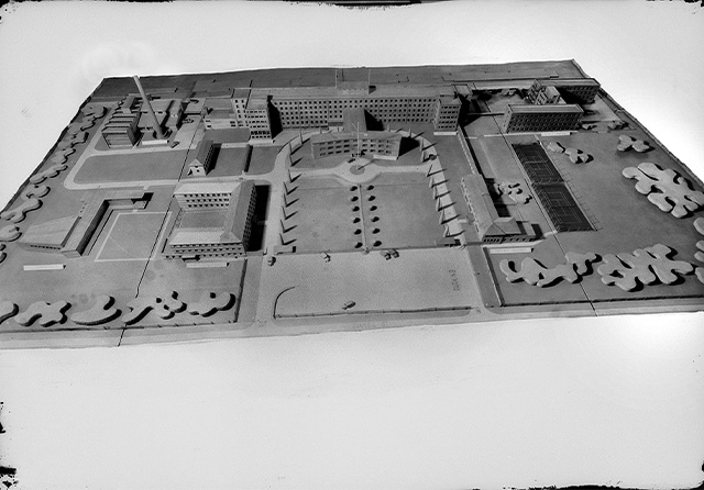 A black and white photograph of a model of a large building complex.