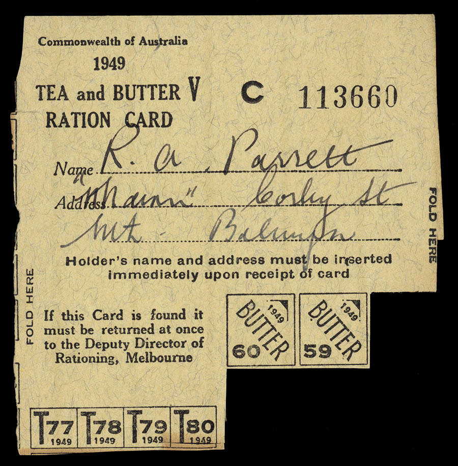A worn beige and black printed card feature the text, Tea and Butter Ration Card, Name, Address, Holders name and address must be inserted immediately upon receipt of card. If this Card is found it must be returned at once for the Deputy Director of Rationing, Melbourne. The bottom of the card has attached two tear away tabs for butter.